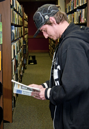 Photo of Garland County Library patron browsing books