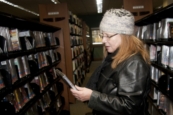 Photo of woman selecting DVDs at the Garland County Library